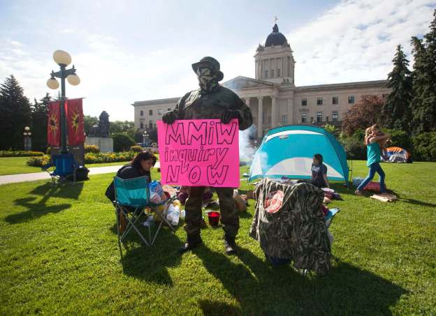 The Urban Warrior Alliance camps outside the legislature to protest the delays in the missing and murdered indigenous women inquiry Tuesday. RUTH BONNEVILLE / WINNIPEG FREE PRESS