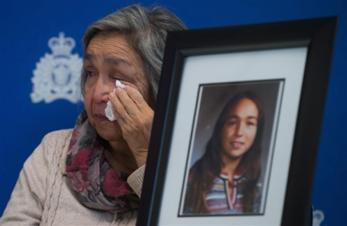 Madeline Lanaro, whose 12-year-old daughter Monica Jack was murdered in 1978, wipes away tears after the RCMP announced an arrest in connection to her murder and that of Kathryn-Mary Herbert, during a news conference in Surrey, B.C. December 1, 2014