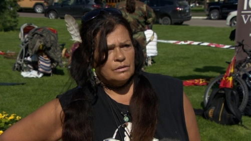 Protester Sandy Banman says the Manitoba government is stalling the inquiry. (CBC)