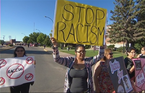 Many of the people gathered outside court as Gerald Stanley made his first appearance rallied for an end to racism in Saskatchewan. (CBC)