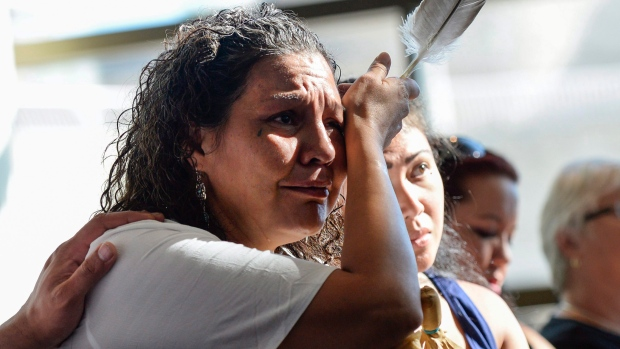 Ceejai Julian, who lost two sisters, wipes her eye during the announcement of the inquiry into Murdered and Missing Indigenous Women at the Museum of History in Gatineau, Quebec on Wednesday, Aug. 3, 2016. (Justin Tang/The Canadian Press)