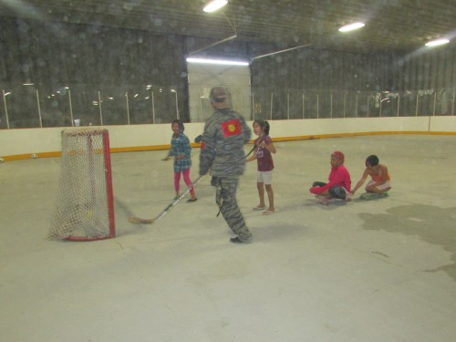 Members of the urban warrior alliance play floor hockey with kids from Bloodvein First Nation.