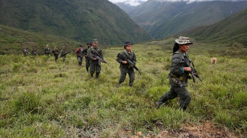Members of the 51st Front of the FARC patrol in the remote mountains of Colombia. Credit: Reuters