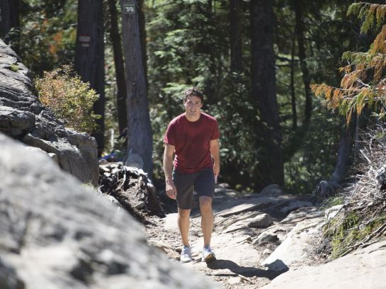 Liberal Leader Justin Trudeau in B.C. last year, hiking the Grouse Grind on the North Shore during his victorious federal election campaign. Now, as prime minister, his government faces a difficult West Coast environmental issue with the proposed Northern Gateway pipeline project across northern B.C. JONATHAN HAYWARD / THE CANADIAN PRESS FILES