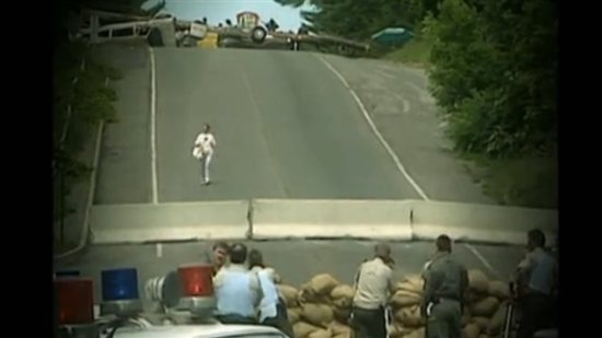 Immediately after the fatal first shooting battle, police set up their own barrier down the hill from the Mohawk barrier where the two sides remained in a tense months-long standoff.