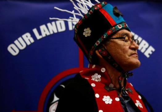 Chief Na'moks (John Ridsdale) of the Wet'suwet'en Nation listens to a speech during the signing of the Treaty Alliance Against Tar Sands Expansion during an announcement on oil sands pipelines, with special relevance for the Kinder Morgan and Northern Gateway proposals, at the Musqueam Community Centre in Vancouver, British Columbia, Canada, September 22, 2016. REUTERS/Ben Nelms