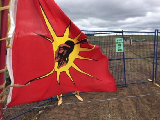 Members of the Sipekne'katik band have placed a flag and 10 treaty-based fishing traps near the AltaGas Ltd. work site on the Shubenacadie River. (Robert Short/CBC)