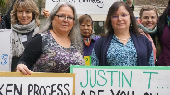 Katzie First Nation Chief Susan Miller (left) and her sister, Debbie Miller, stand with protesters outside the Kinder Morgan Trans Mountain hearings in Burnaby, B.C. on Wed. Jan. 20, 2016. Photo by Elizabeth McSheffrey.