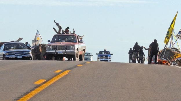 Protesters block North Dakota Highway 1806 on Sunday. The roadblock north of the camp on Highway 1806 was removed after negotiations with law enforcement, who told protesters they would be liable if an emergency would occur and first responders could not get through, according to the Morton County Sheriff's Department. Photo by Tom Stromme / Bismarck Tribune