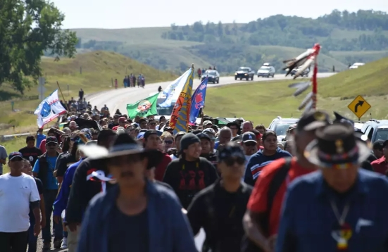 Protestors march to a construction site for the Dakota Access Pipeline to express their opposition to the pipeline, at an encampment where hundreds of people have gathered to join the Standing Rock Sioux Tribe's to protest against the construction of the new oil pipeline, near Cannon Ball, North Dakota, on September 3, 2016.