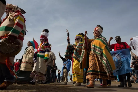 Members of the Pikuni Blackfeet Nation march into Sacred Stone Camp near Cannonball, ND