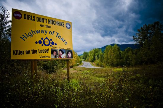 """""""Killer on the Loose!' is the warning on a prominent billboard beside Highway 16 in northern B.C., where numerous young women have died or disappeared. (CBC )"""
