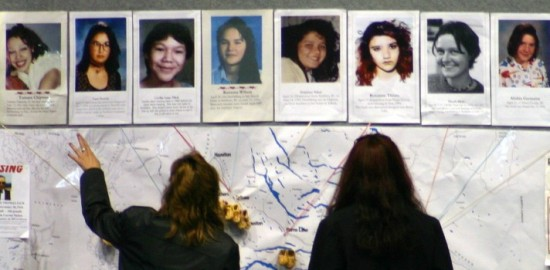 Women pore over a map that marks deaths and disappearances along the Highway of Tears. (Contributed/UBCIC)