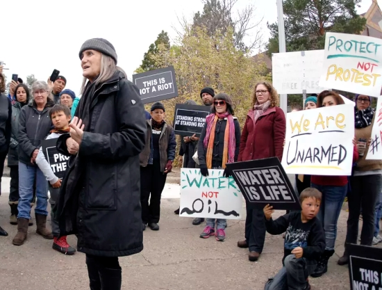 Journalist Amy Goodman, left, speaks with supporters in Mandan, North Dakota before learning the rioting charge filed against her was dismissed by a SouthCentral district judge Monday, Oct. 17, 2016.