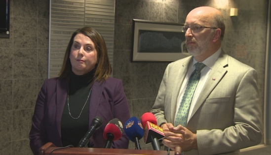 Minister Siobhan Coady and Perry Trimper at a new conference Wednesday, where they announced government is telling Nalcor to clear more forest cover from the Muskrat Falls reservoir site. (Ted Dillon/CBC)
