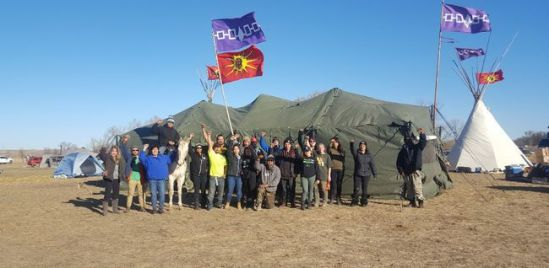 A group shot of different representatives of the Haudenosaunee camp. Seneca , Cayuga, Onondaga , Oneida , and Mohawks all standing together in defense of the water at Standing Rock. Handout/Cornwall Standard-Freeholder/Postmedia Network