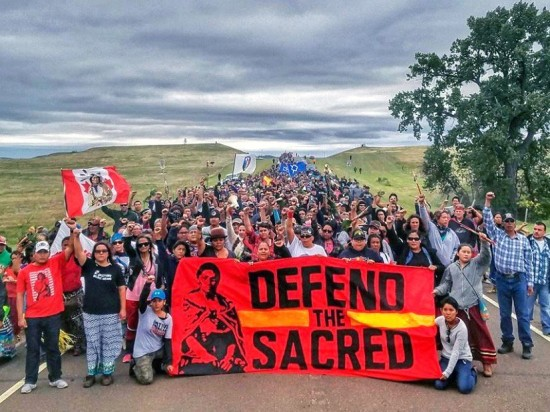 Hundreds of people marched peacefully on Sept. 4 to protest the destruction of sacred sites and burial grounds in the path of the Dakota Access Pipeline in North Dakota. Dallas Goldtooth
