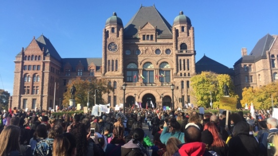 Demonstrators gathered in front of Ontario's legislature in Toronto on Saturday, November 5. (Mathieu Simard/CBC/Radio-Canada)