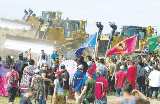 Standing Rock Sioux Tribe members and supporters confront bulldozers working on the Dakota Access pipeline in September. (AFP/Getty Images file photo)