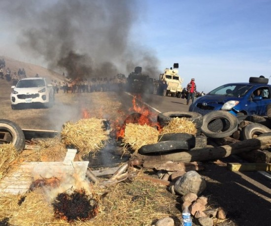 Dakota Access pipeline protesters confront law enforcement on Oct. 27, near Cannon Ball, N.D. (Caroline Grueskin/The Bismarck Tribune/Associated Press)