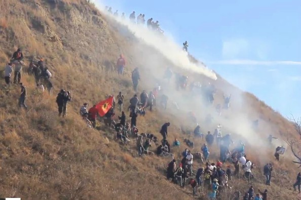 Another Tear Gas Standoff With Police As Water Protectors Defend Sacred Land (Photo by Unicorn Riot, the Dakota Access Pipeline)