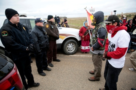 Protesters square off against police between the Standing Rock Reservation and the North Dakota Access Pipeline route, outside the little town of Saint Anthony, N.D. on Oct. 5. (Terray Sylvester/Reuters)