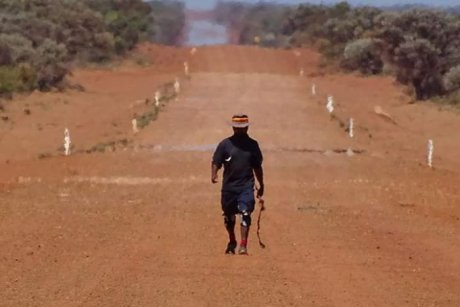 PHOTO Mr Pryor battled heat waves walking through the Western Desert.