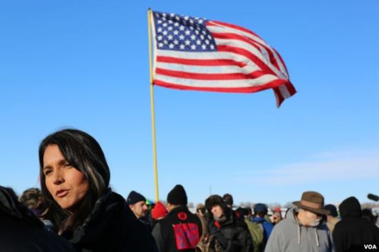U.S. Representative Tulsi Gabbard of Hawaii speaks to reporters after addressing veterans near the Standing Rock camp in North Dakota (E. Sarai/VOA)