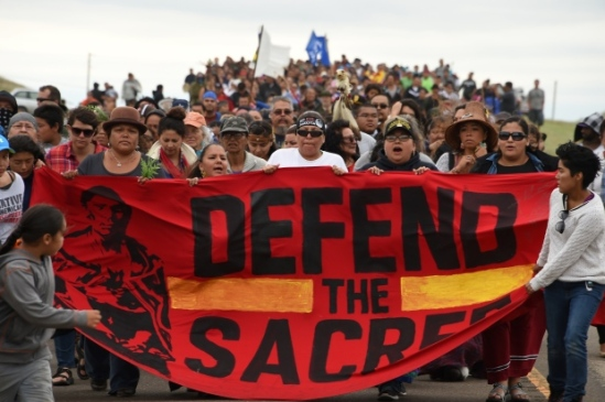 Indigenous people march to a sacred burial site that was disturbed by bulldozers building the Dakota Access pipeline (DAPL) near the Sioux Tribe's Standing Rock Reservation. (Robyn Beck/AFP/Getty Images)