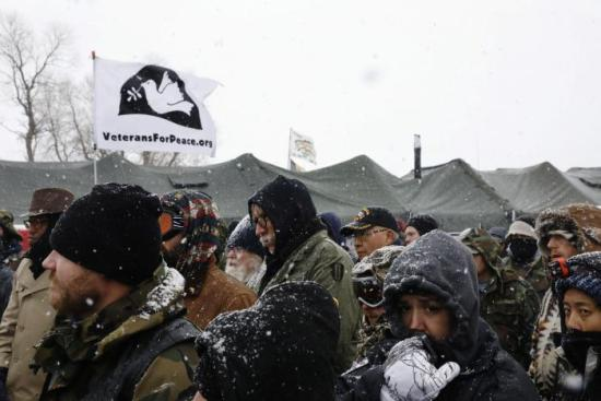 "Veterans gather for a briefing inside of the Oceti Sakowin camp during a snow fall as ""water protectors"" continue to demonstrate against plans to pass the Dakota Access pipeline adjacent to the Standing Rock Indian Reservation, near Cannon Ball, North Dakota, U.S., December 5, 2016. REUTERS/Lucas Jackson"
