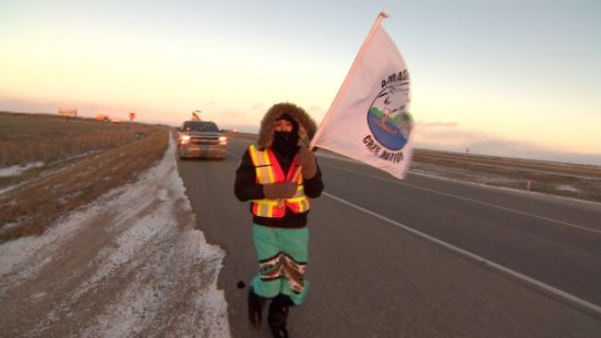 A group of pipeline protesters passed through Saskatoon on Tuesday as part of a long trek from Stanley Mission, Sask. to Standing Rock, N.D. (Don Somers/CBC News)