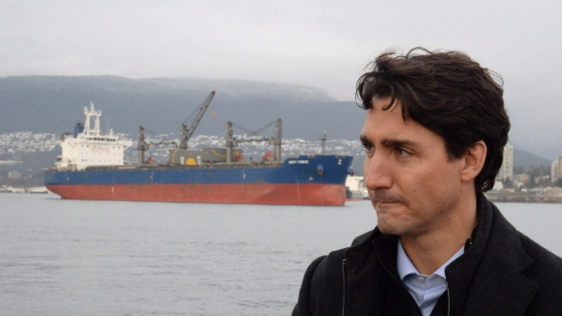 Prime Minister Justin Trudeau tours a tugboat in Vancouver harbour on Tuesday. The federal Liberal government says Canada will ban offshore and gas licensing in Arctic waters. (Jonathan Hayward/Canadian Press)