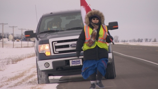 Marjorie Roberts-McKenzie walking south of Regina on Highway 6, is one of eight Stanley Mission residents walking to Standing Rock Sioux Tribe reservation in support of the protests towards the Dakota Access Pipeline. (William Desaulniers/CBC)
