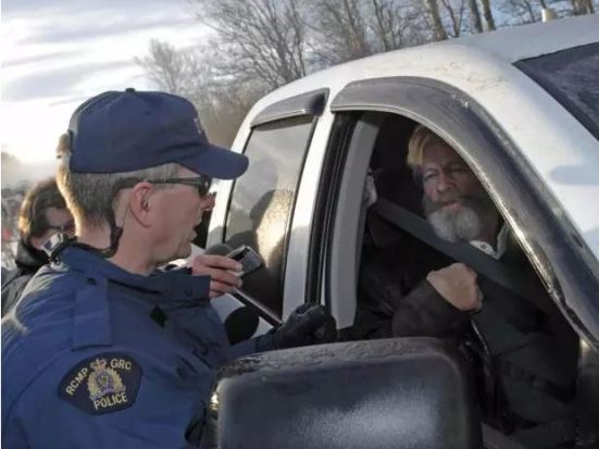Wiebo Ludwig arrives at a police barricade outside his farm near Hythe, Alta. in 2010, after spending the night at the RCMP detatchment in Grande Prairie, Alta..