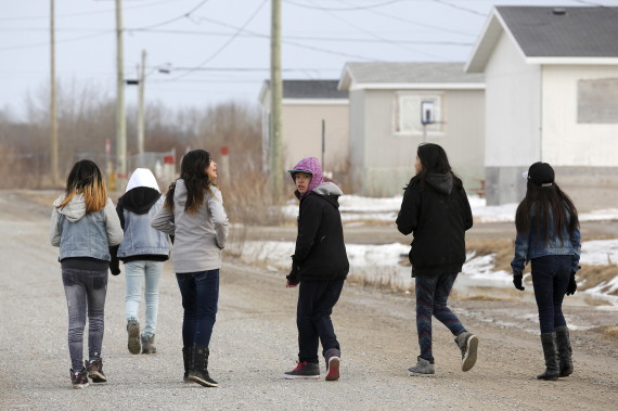 FILE: Girls walk on a street in the Attawapiskat First Nation in northern Ontario, Canada, April 14, 2016. REUTERS/Chris Wattie