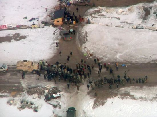 Law enforcement officers line up against protesters during the eviction of Dakota Access pipeline opponents from a camp on private property in southern North Dakota near Cannon Ball, North Dakota, Feb. 1, 2017.