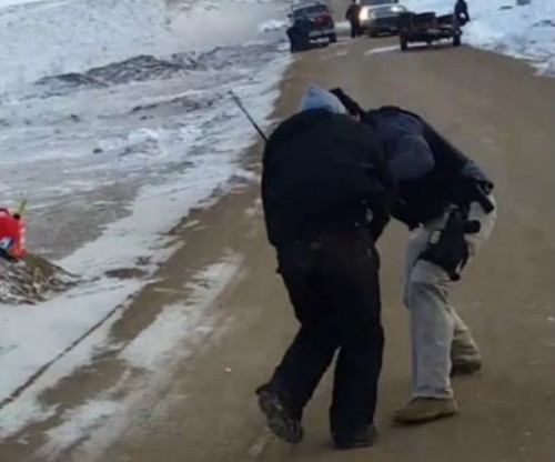BIA agent Attacks female Water Protector with Baton during Arrest in Standing Rock