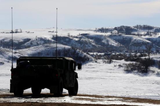 A North Dakota National Guard vehicle idles on the outskirts of the Dakota Access oil pipeline protest camp near Cannon Ball, North Dakota, U.S., January 29, 2017. REUTERS/Terray Sylvester