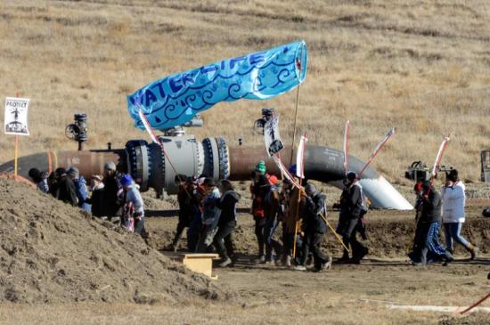 Protesters march along the pipeline route during a protest against the Dakota Access pipeline near the Standing Rock Indian Reservation in St. Anthony, North Dakota, U.S. November 11, 2016. REUTERS/Stephanie Keith