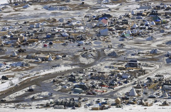 This aerial photo shows the Oceti Sakowin camp, where people have gathered to protest the Dakota Access pipeline on federal land, Monday, Feb. 13, 2017, in Cannon Ball, N.D.