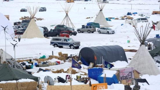 Signs hang in the Dakota Access Pipeline protest camp on the edge of the Standing Rock Sioux Reservation near Cannon Ball, North Dakota, U.S., January 24, 2017. (Terray Sylvester/Reuters )