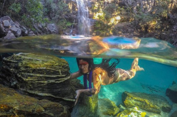 These incredible images offer a rare glimpse of life within remote Brazilian tribes and show women diving underwater